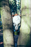 Gas mask between trees Royalty Free Stock Images