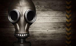 Gas mask on wooden background Royalty Free Stock Photos