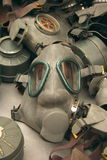 Gas Masks. Pile of rubbery gas masks with canisters and straps tossed together in a casual manner.  Masks are colored in a military green tone Royalty Free Stock Photos