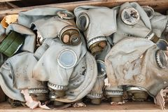 Gas masks in a box. Old gas masks lie in the box royalty free stock photo