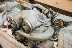 Gas masks in a box. Old gas masks lie in the box royalty free stock image