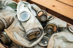 Gas masks in a box. Old gas masks lie in the box royalty free stock photography