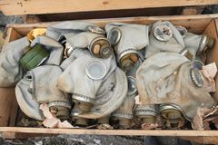 Gas masks in a box. Old gas masks lie in the box royalty free stock photos