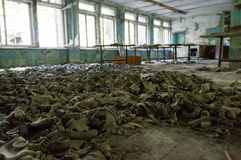 Gas masks cover the floor of an abandoned building in Chernobyl stock photography