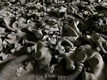 Gas masks on the ground stock images