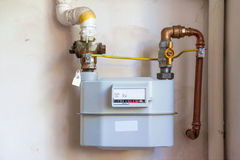 Gas meter on the white wall Royalty Free Stock Photos