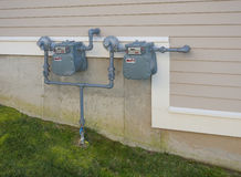 Gas meters. On outside wall of a residential house royalty free stock photo