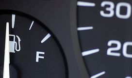 Gas Mileage. A up close image of a fuel gauge and a speedometer Royalty Free Stock Image