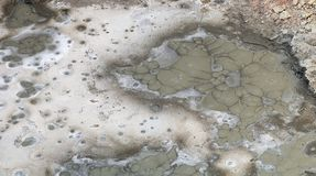 Gas. Mud with natural bubbles of gas at the bottom of the crater in the Ahal Province, near the Derweze area along the road, in the Karakum desert, to the Door Stock Photo