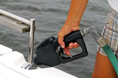 Gas nozzle in boat Royalty Free Stock Images