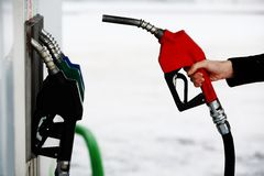 Gas nozzle in woman's hand Stock Images