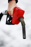 Gas nozzle in woman's hand Royalty Free Stock Photos
