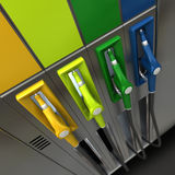 Gas nozzles in bright colors. 3D rendering of four brightly colored gas pumps Royalty Free Stock Photo