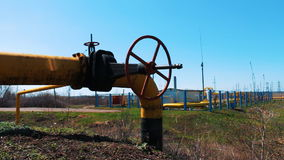 Gas and oil industry. Pipeline with a large shut-off valve. Station for processing and cleaning oil and gas. Production