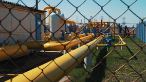 Gas and oil pipeline at the plant. Station for processing and storing natural gas. Transportation of raw materials