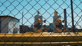 Gas and oil pipeline. Station refinery of petroleum products and natural gas. Shut-off valves and a yellow pipeline. A stock video