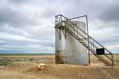 Gas and oil production facilities. In eastern Colorado - a collecting tank Royalty Free Stock Photography