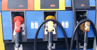 Gas or oil pump nozzles in a service station Royalty Free Stock Photography