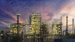 Gas oil refinery storage tank . A large oil-refinery plant  storage tanks and sunrise Royalty Free Stock Image