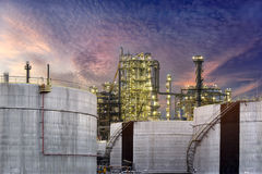 Gas oil refinery storage tank . A large oil-refinery plant  storage tanks and sunrise Royalty Free Stock Photo