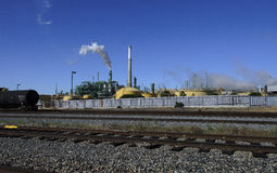 Gas and Oil Refinery with White Smoke Stock Images