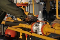 Gas operator. Gas and oil production operator maintains Royalty Free Stock Image