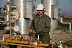 Gas operator. Gas and oil production operator maintains Stock Photo