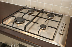 Gas Oven Hob. Modern integrated gas hob on kitchen surface stock photography
