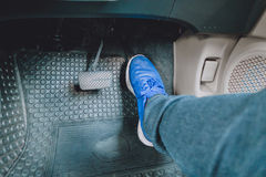 The gas pedal brake pedal. On the blue shoes Royalty Free Stock Image