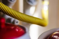 Gas Pipe In House Kitchen With Soft Focus Background. A yellow natural gas pipe coming in to the heater placed in a typical Turkish home kitchen with soft focus royalty free stock images