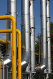 Gas pipeline. The gas pipeline - much pipes over blue sky royalty free stock photo