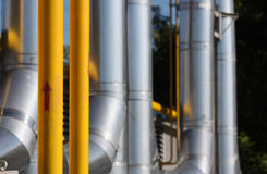 Gas pipeline. The gas pipeline - focus on yellow pipe with red arrow royalty free stock image