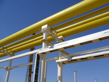 Gas Pipeline. Yellow gas pipelines at the blue sky background Royalty Free Stock Images