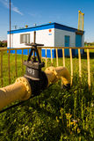 Gas pipeline against background of the gas distribution station in the village. Russia Royalty Free Stock Photos