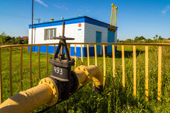 Gas pipeline against background of the gas distribution station in the village. Russia Stock Images