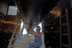 Gas pipeline construction. A worker works on the construction of a pipeline Stock Photo