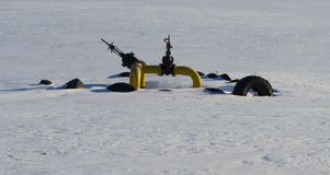 Gas pipeline equipment in the winter field stock photography