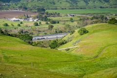 Gas Pipeline going through verdant hills alongside a highway, San Jose, California stock photos