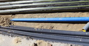Gas pipeline inside the excavation in road constructio. Corrugated pipes and gas pipelines inside the excavation in road construction Stock Image