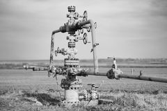 Gas pipeline middle of the field. Extraction of gas from storage, grayscale effect Stock Images