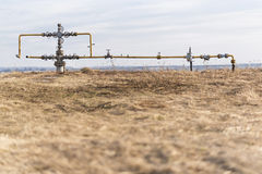 Gas pipeline middle of the field. Extraction of gas from storage. Royalty Free Stock Photography