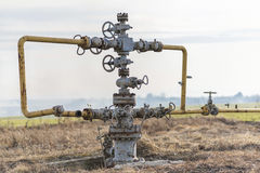 Gas pipeline in the middle of the field. Extraction of gas from storage. Royalty Free Stock Images