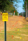 Gas Pipeline Sign. Sign indicating gas pipeline and line survey markers Stock Photo
