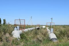 The gas pipeline through the small river. Equipment of oil and gas crafts royalty free stock image