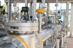 Gas pipeline and valve. Gas pipeline with hand operating valve Royalty Free Stock Image
