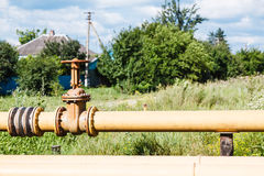 Gas pipeline in village in summer day Royalty Free Stock Photography