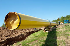 Gas pipelines against blue sky stock images