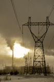 Gas power plant in cold winter landscape during sunset Stock Photo