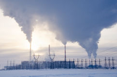 Gas power plant in cold winter landscape during sunset Stock Image