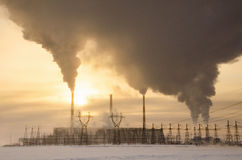 Gas power plant in cold winter landscape during sunset Stock Photography